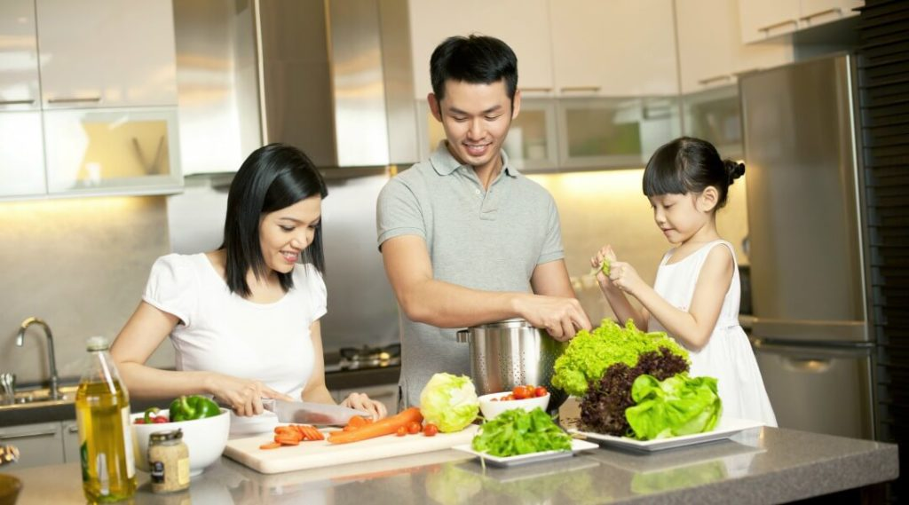 Asian family cooking in renovated kitchen