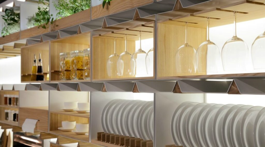 glasses and plates stacked on kitchen shelves