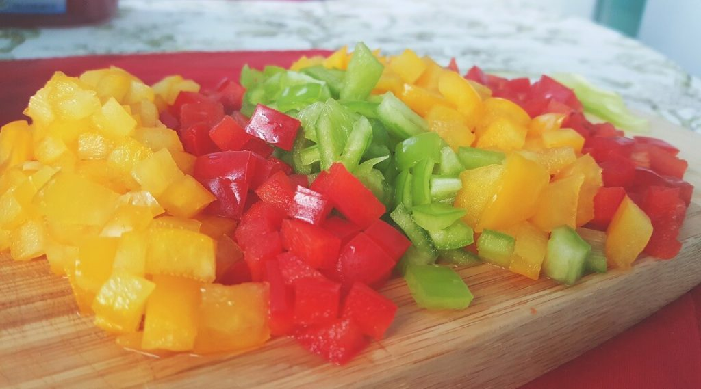 chopped vegetable on kitchen chopping board